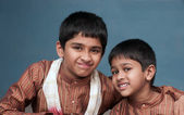 Two handsome indian brothers looking happy — Stock Photo