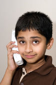 An handsome Indian kid talking on the phone — Stock Photo