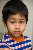 Indian kid looking sad — Stock Photo