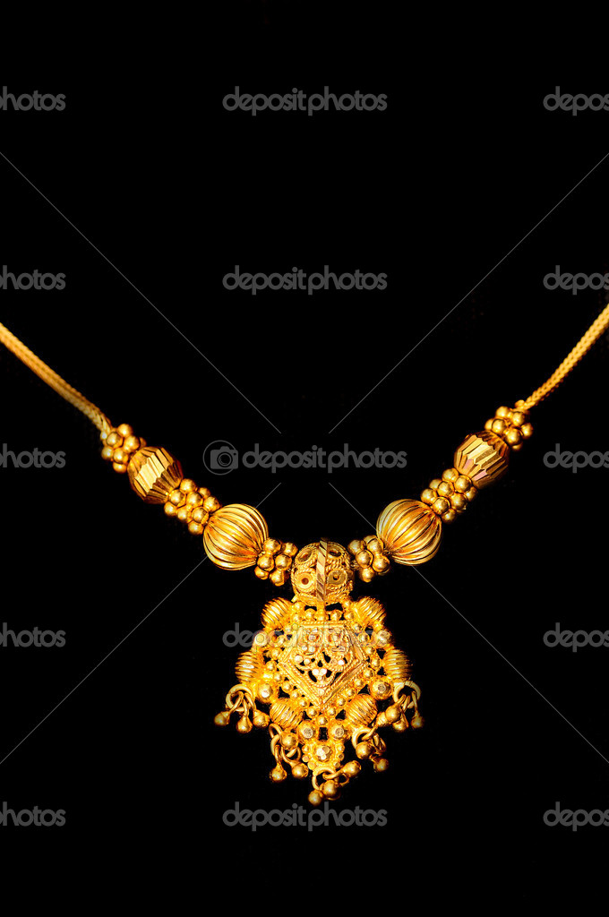 Beautiful Indian artwork displayed at a golden pendant — Stock Photo #4689938