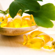 Ginko biloba essential oil with fresh leaves - beauty treatment - Photo