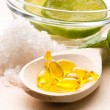 Lemon bath - bath salt, capsule and fresh fruits - Stock Photo
