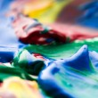 Brush mixing paint on palette — Stock Photo