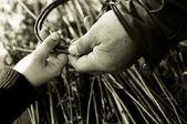 Man teaching child making a wicker basket — Stock Photo