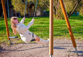 Swinging Woman — Stock Photo