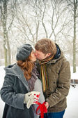 Kissing Couple While Snowing — Stock Photo