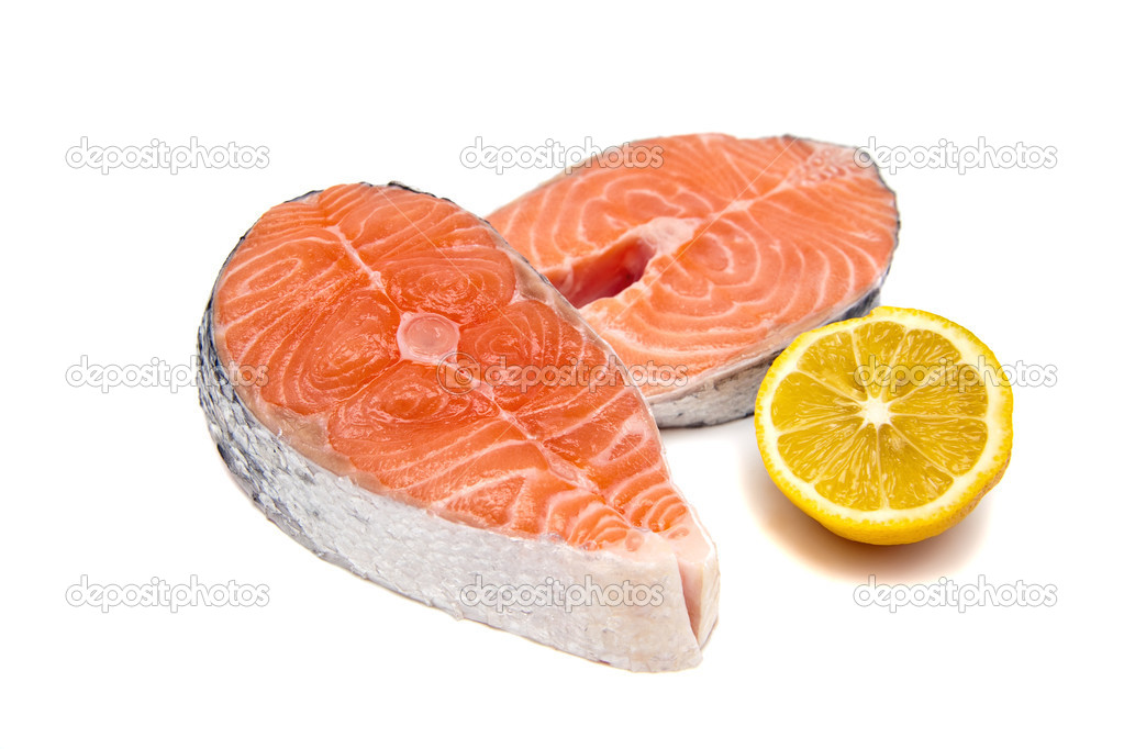Close-up two raw salmon steskes and lemon, isolated on white background — Stock Photo #5377484