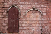 Old wall with a door — Stock Photo