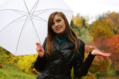 Young women with umbrella — Stock Photo