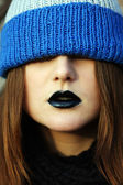 Young woman's lips with black lipstick — Stock Photo
