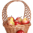 Wattled basket with delicious red apples - Stock Photo