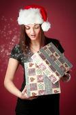 Sexy girl opening Christmas gift — Стоковое фото