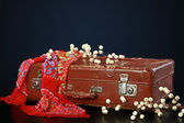 Old suitcase with decorations — Stock Photo