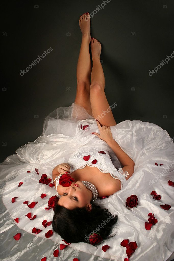 Sexy young bride on dark background — Stock Photo #4021296