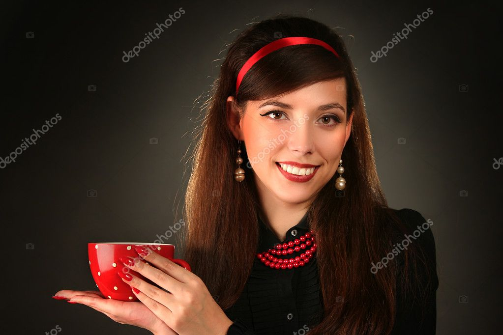 Beautiful retro woman with red cup — Stock Photo #4354104