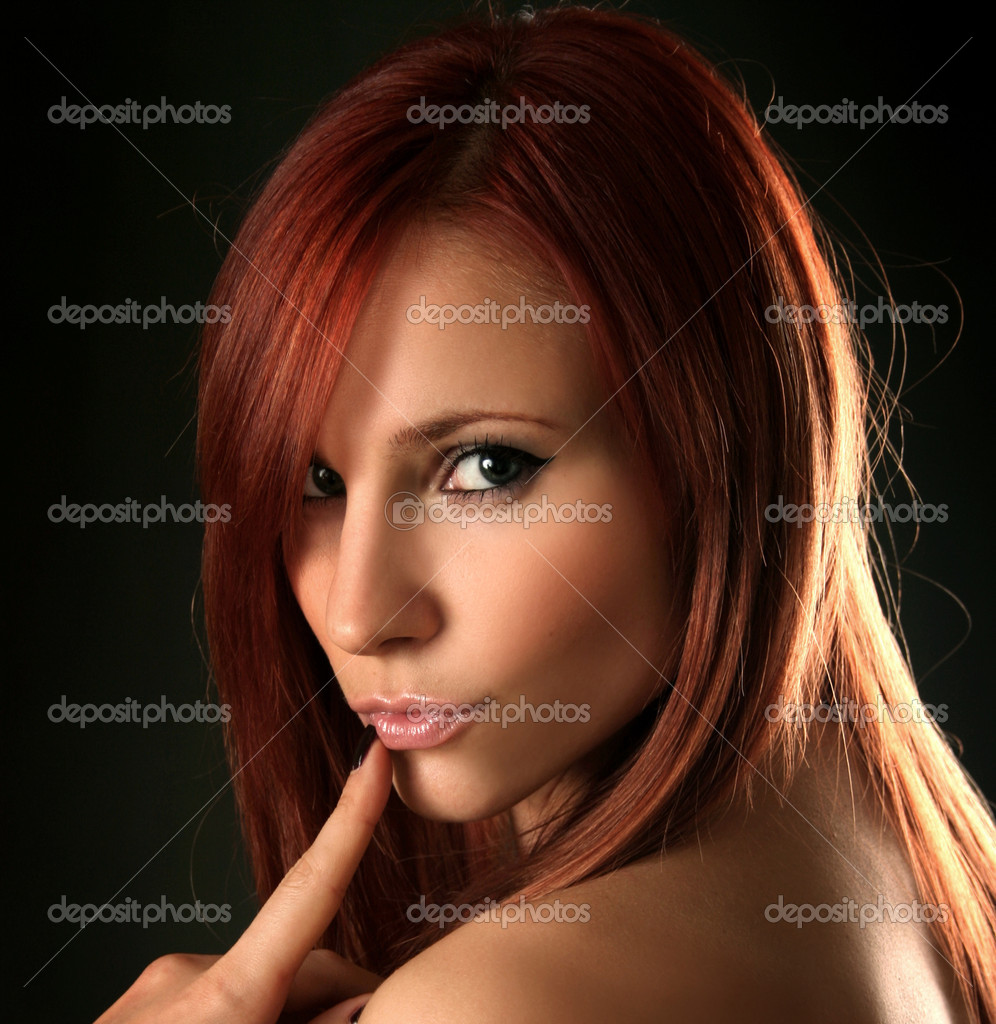 Beautiful young woman on dark background — Stock Photo #5249527