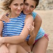 Close-up of two young women smiling on the beach — Stock Photo