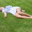Stock Photo: Beautiful girl lying down of grass