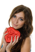 Smiling girl holding a gift — Stock Photo