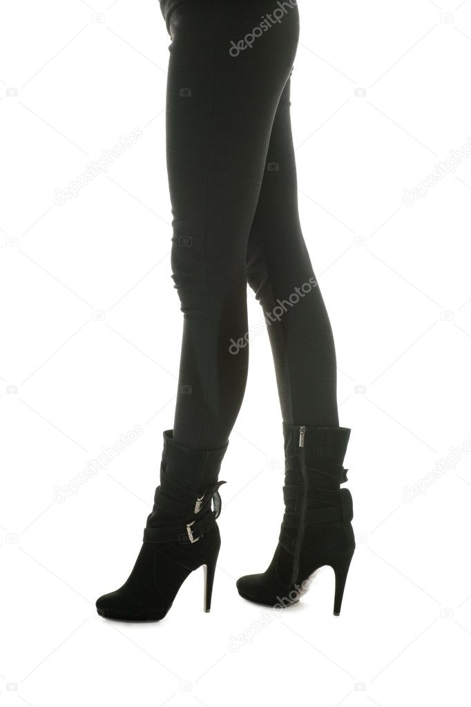 Shapely legs, a young woman in tight pants and leather boots. — Stock Photo #4153961