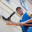 Installer sets new air conditioner — Stock Photo #4395614