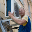 Royalty-Free Stock Photo: Installer sets a new air conditioner