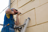 Adjuster works with a drill — Stock Photo
