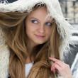 Blond girl in fur coat — Stock Photo
