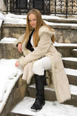 Blonde frecked girl in fur coat — Stock Photo