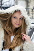 Blond girl in fur coat — Stock Photo