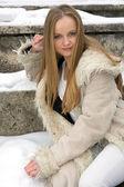 Blond freckled girl in fur coat — Stock Photo