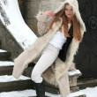 Blond girl in fur coat - Foto Stock