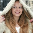 Blond girl in fur coat - Stock Photo
