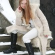 Blond girl in fur coat — Stock fotografie