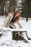 Blond girl in fur coat smiling — Stock Photo