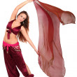 Beautiful young belly dancer with a veil — Stock Photo