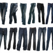 Collection of various types of blue jeans trousers - Stock Photo