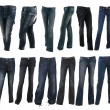 Collection of various types of blue jeans trousers — Stock Photo