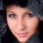 Woman and black fur — Stock Photo #4123742