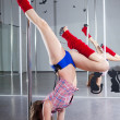 Young pole dancer — Stock Photo