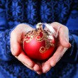 Christmas balls in hands — Stock Photo