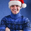 Man in christmas hat — Stock Photo