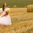 Woman in field — Stock Photo #4901204