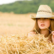Cowgirl in straw - Stock Photo