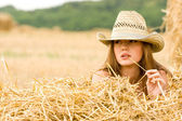 Cowgirl in straw — Stock Photo