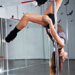 Young woman dancing with pole — Stock Photo