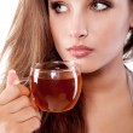 Woman with tea — Stock Photo
