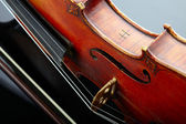 Violin and bow on dark background — Stock Photo