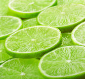 Lime slices background — Stock Photo