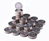 Stacks of coins isolated on white background — Stock Photo
